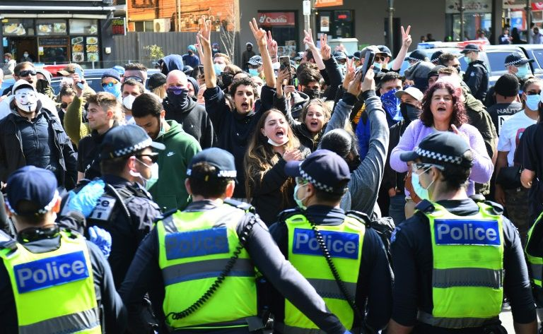 Australian police arrested dozens at an anti-lockdown rally in Melbourne on Sunday after crowds defied stay-at-home orders. Photo: AFP