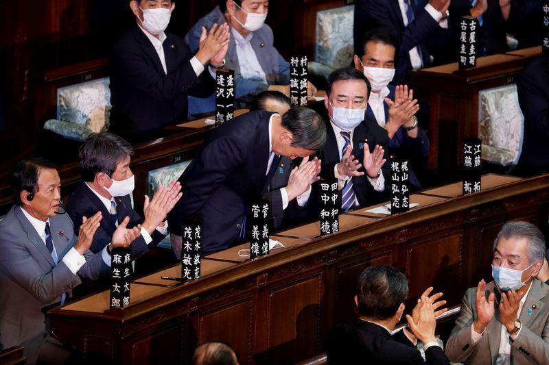 Japan's Suga crafts 'continuity cabinet' after voted prime minister
