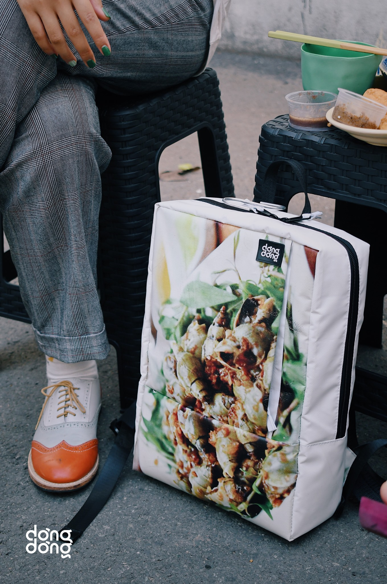 A backpack made from old awning tarp of a snail restaurant in Ho Chi Minh City by Dong Dong Sai Gon is seen in a promo photo published on the brand's Facebook page.