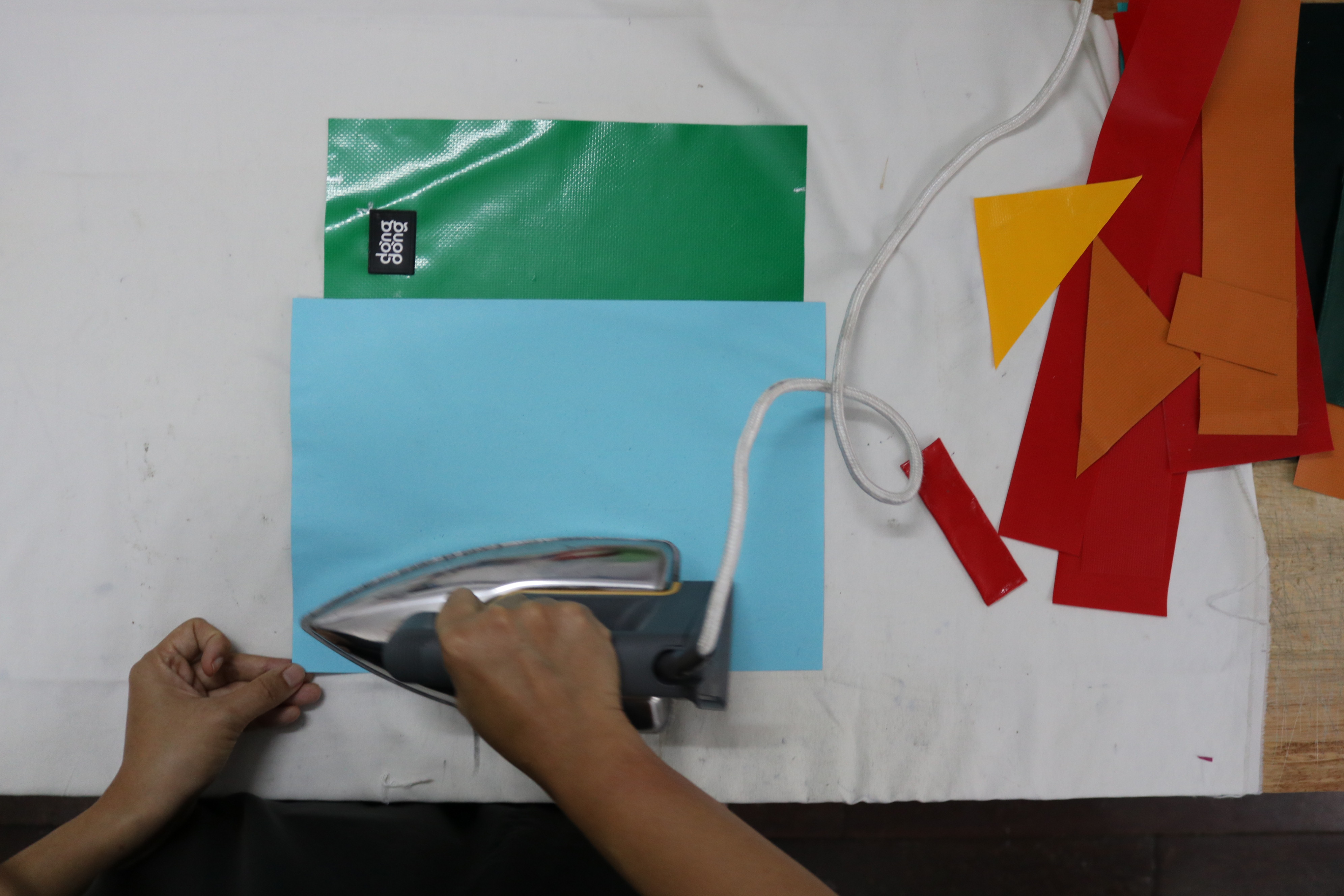Dong Dong Sai Gon's logo on a piece of tarp being ironed at the brand's workshop in Ho Chi Minh City, August 2020. Photo: Hoang An / Tuoi Tre