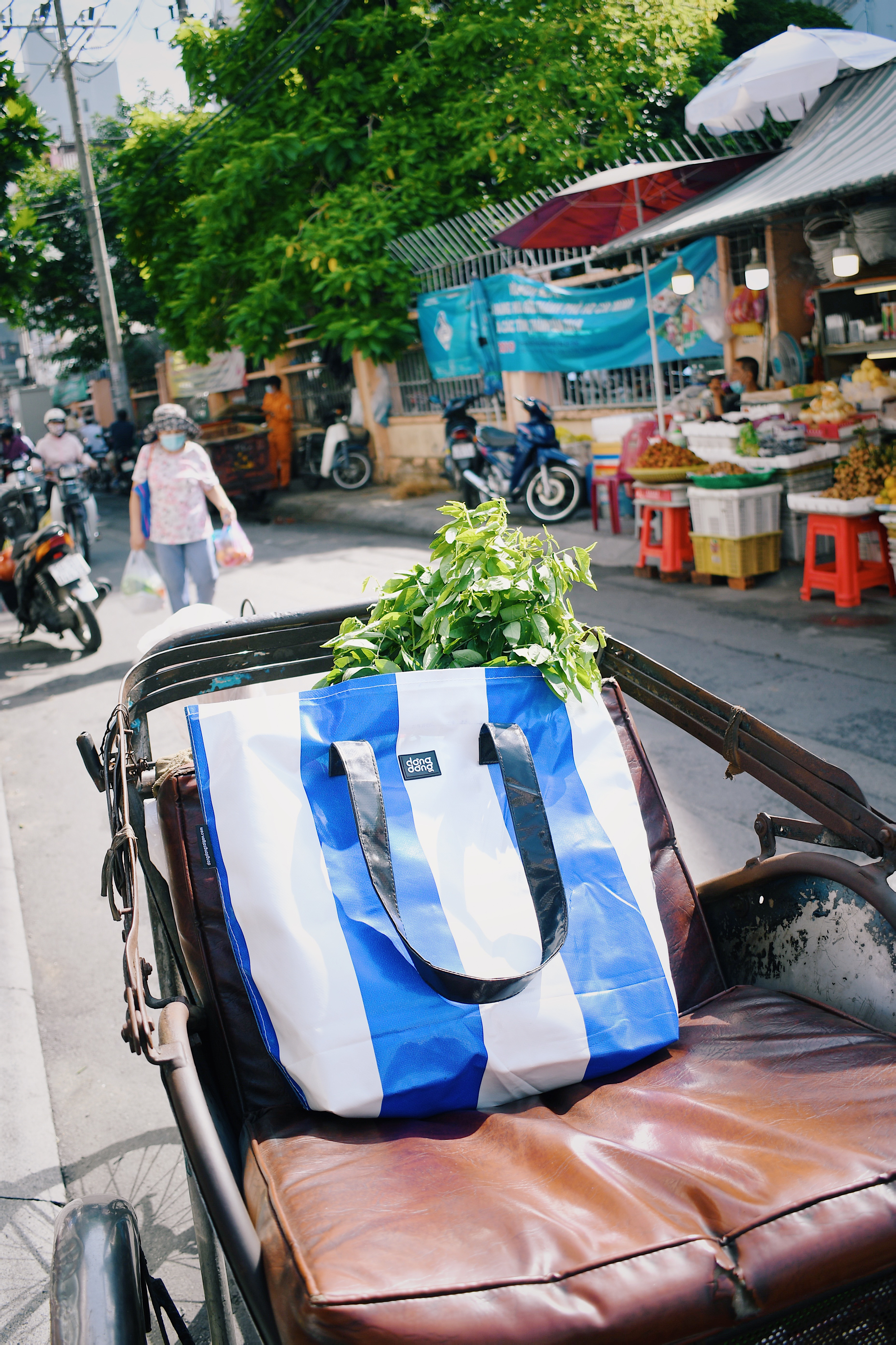A tote bag made from old tarp by Dong Dong Sai Gon is seen in a supplied promo photo.