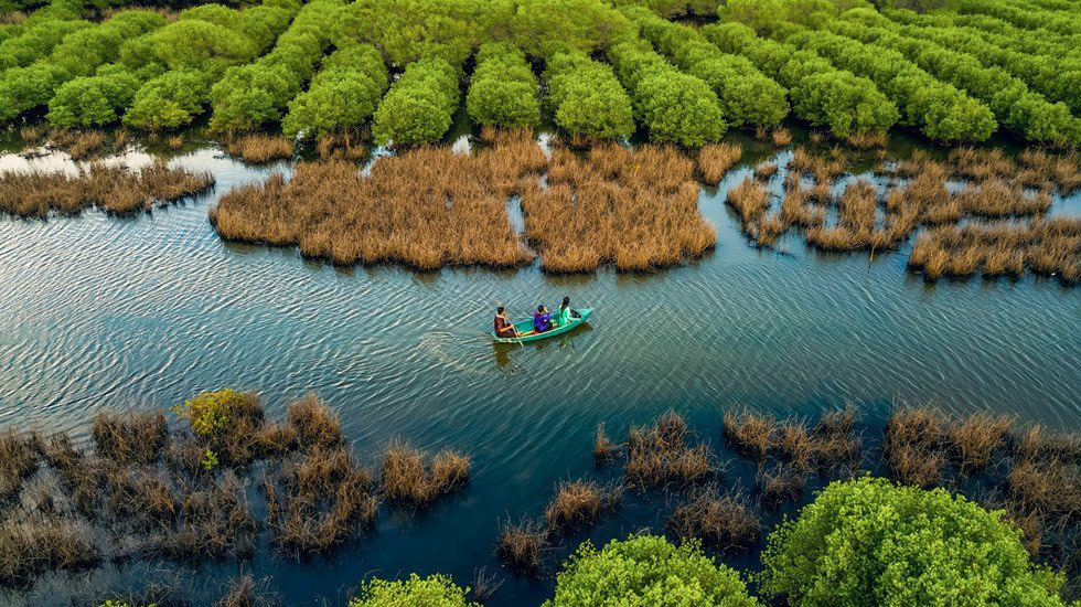 Tourists enjoy nature on a boat ride on Ca Cai Lake in Quang Ngai Province, central Vietnam. Photo: Nguyen Duy Sinh