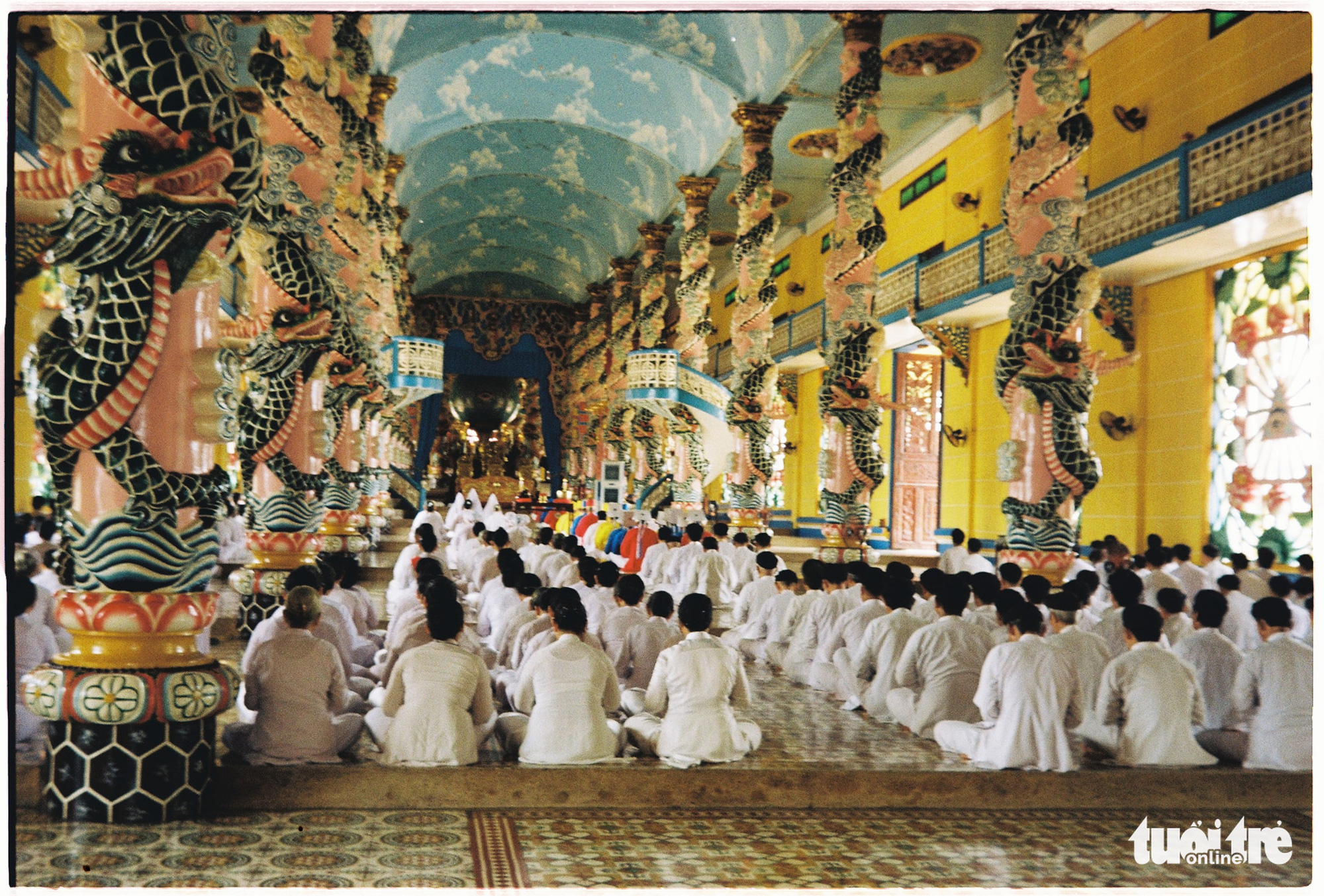 During services, only Caodaism followers are allowed to enter the central chamber of the Cao Dai Holy See in Tay Ninh Province, Vietnam. Photo: Mai Thuong / Tuoi Tre