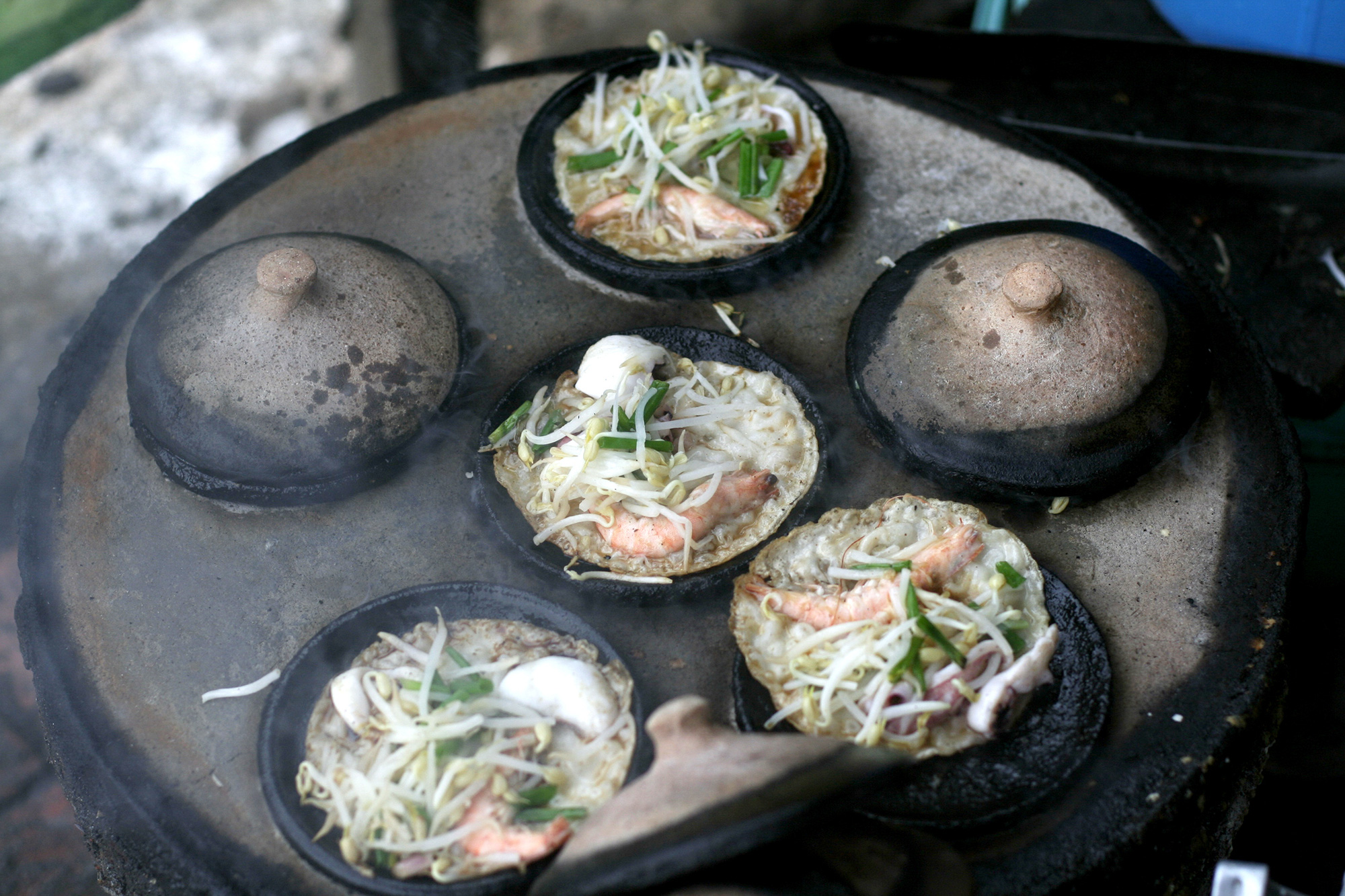 Phan Rang-style 'banh xeo' (Vietnamese pancake) are cooked on a stove in Ninh Thuan Province, Vietnam. Photo: Gia Tien / Tuoi Tre