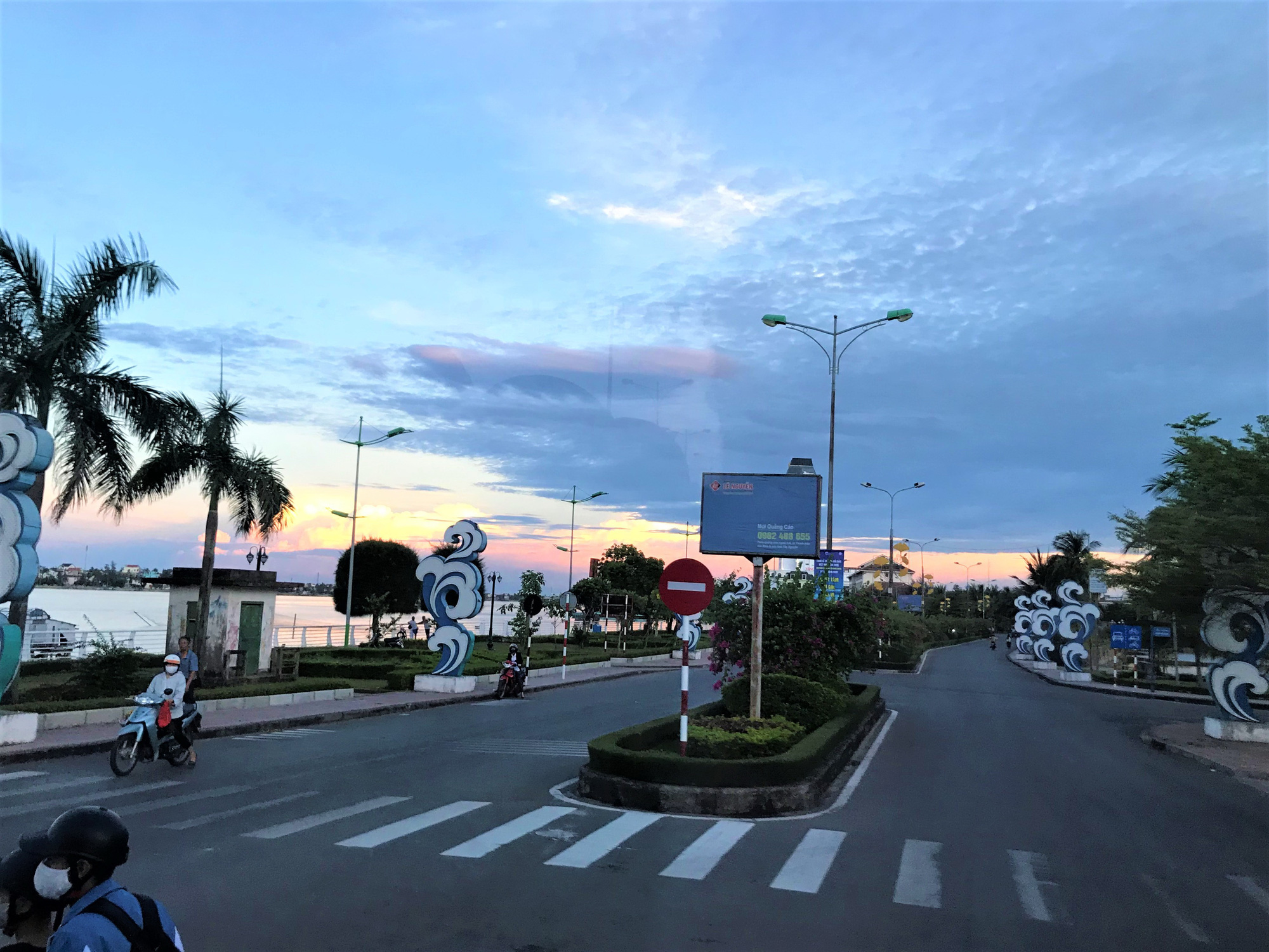 A road of Dong Hoi City in Quang Binh Provincr, Vietnam is almost empty at dusk.