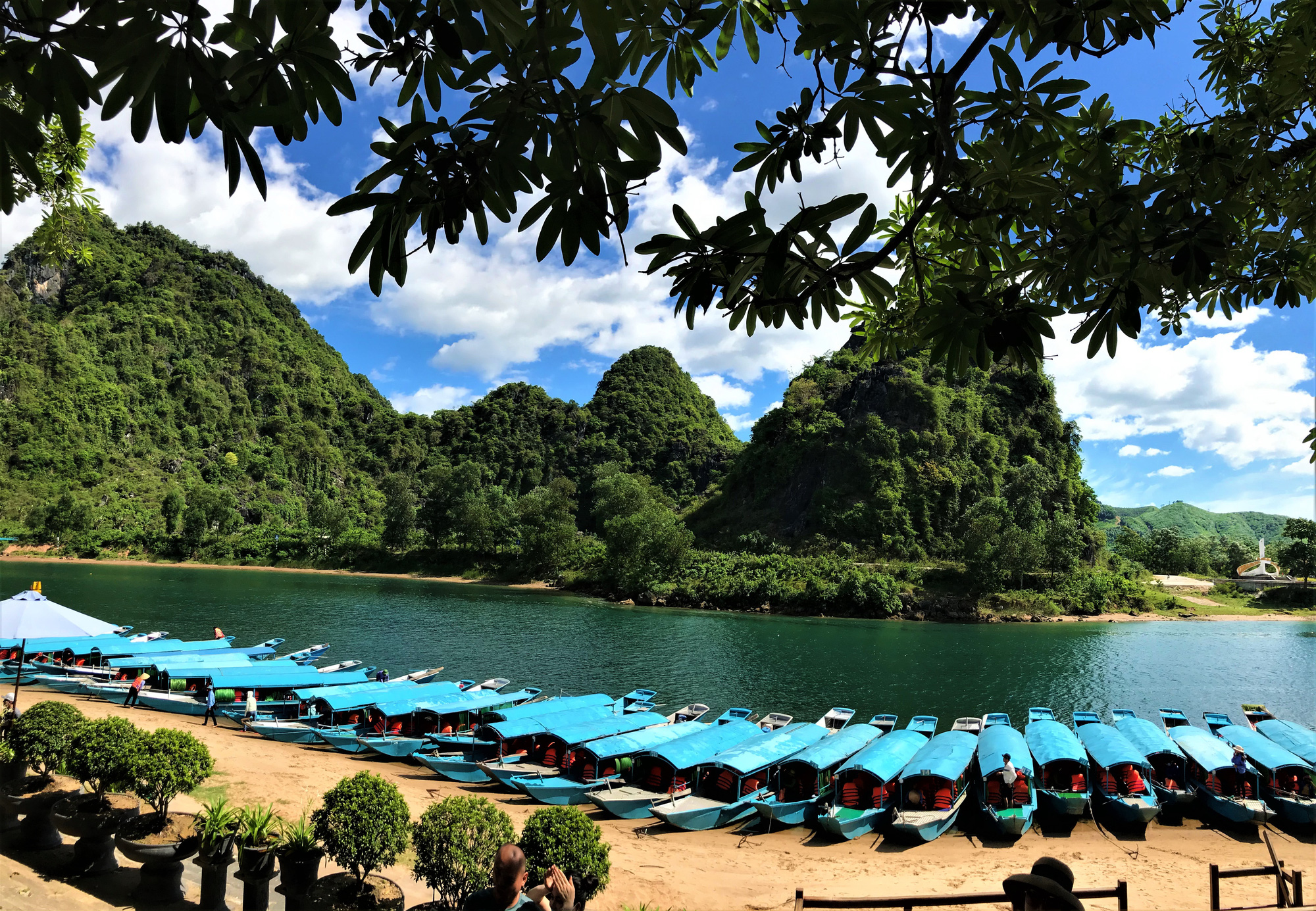 Tourists boat are lined up along the shore in this photo before a trip to Phong Nha Cave in Quang Binh Province, Vietnam.