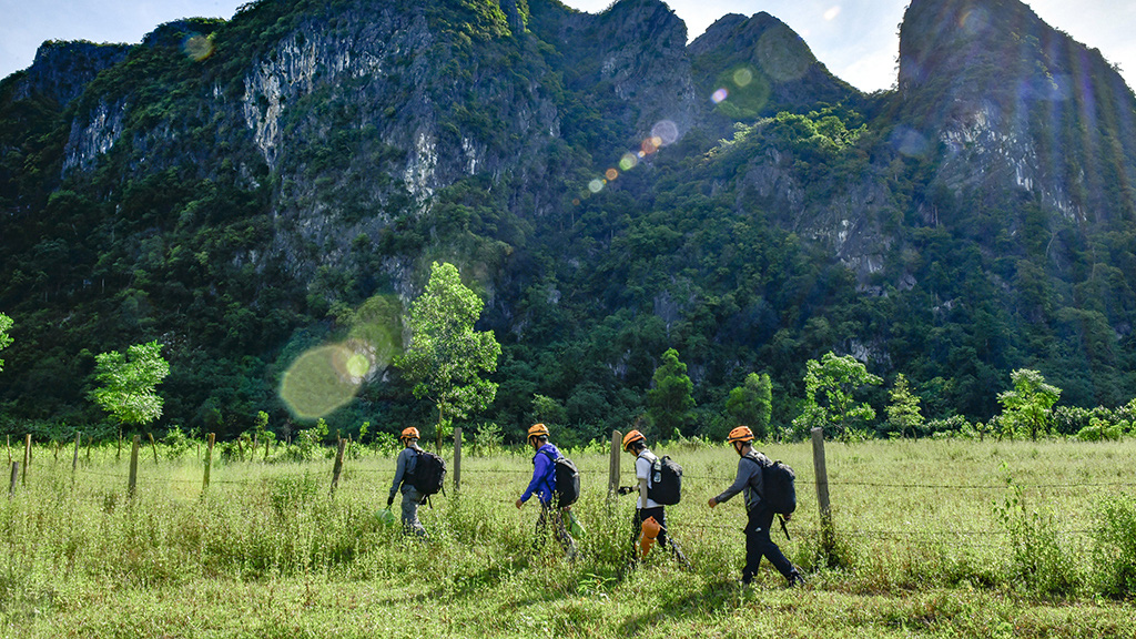 Visitors walk toward the entrance of a cave in Quang Binh Province, Vietnam. Photo: N.V.H.