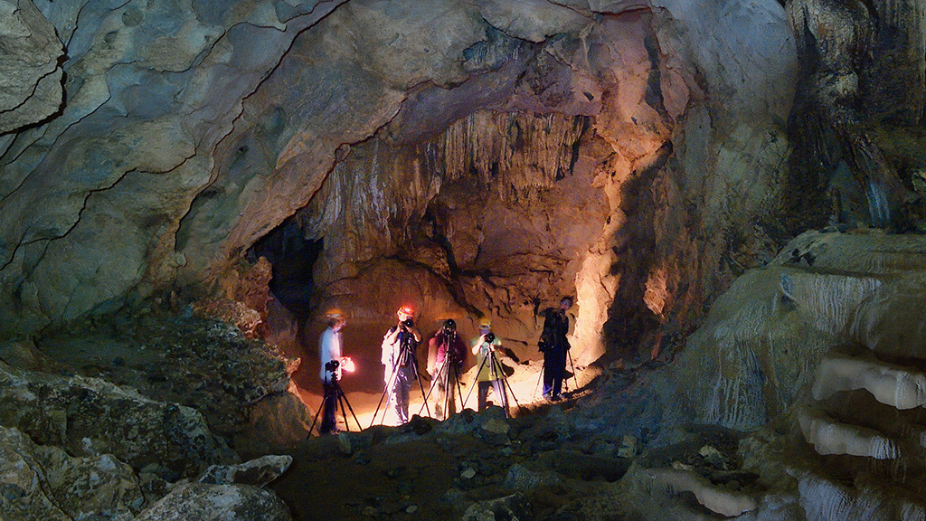 Visitors are seen capturing the scene inside a cave using tripods in this photo taken in Quang Binh Province, Vietnam. Photo: LH.L.