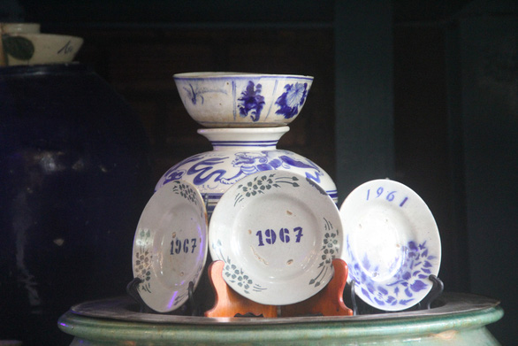 A set of bowls and dishes made in 1967 is displayed in the house of Pham Van Hai in Can Tho City in the Mekong Delta region of Vietnam. Photo: Chi Hanh / Tuoi Tre