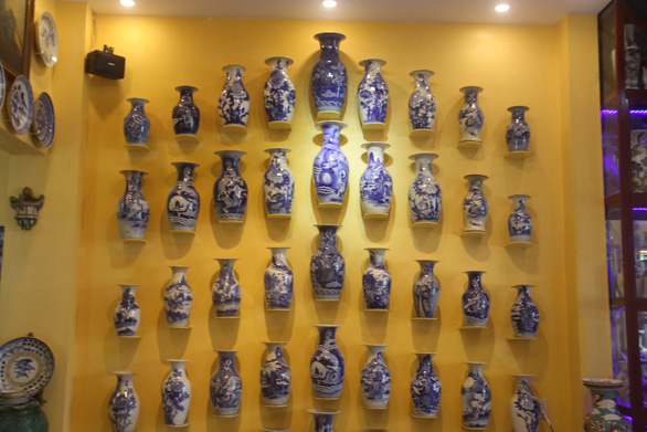 Vintage flower vases are displayed on a wall in the house of Pham Van Hai in Can Tho City in the Mekong Delta region of Vietnam. Photo: Chi Hanh / Tuoi Tre
