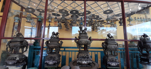 Vintage incense burners and lamps are displayed on the first floor of Pham Van Hai's house in Can Tho City in the Mekong Delta region of Vietnam. Photo: Chi Hanh / Tuoi Tre