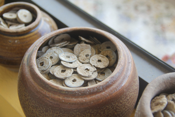 Jars of ancient coins are seen in the house of Pham Van Hai in Can Tho City in the Mekong Delta region of Vietnam. Photo: Chi Hanh / Tuoi Tre