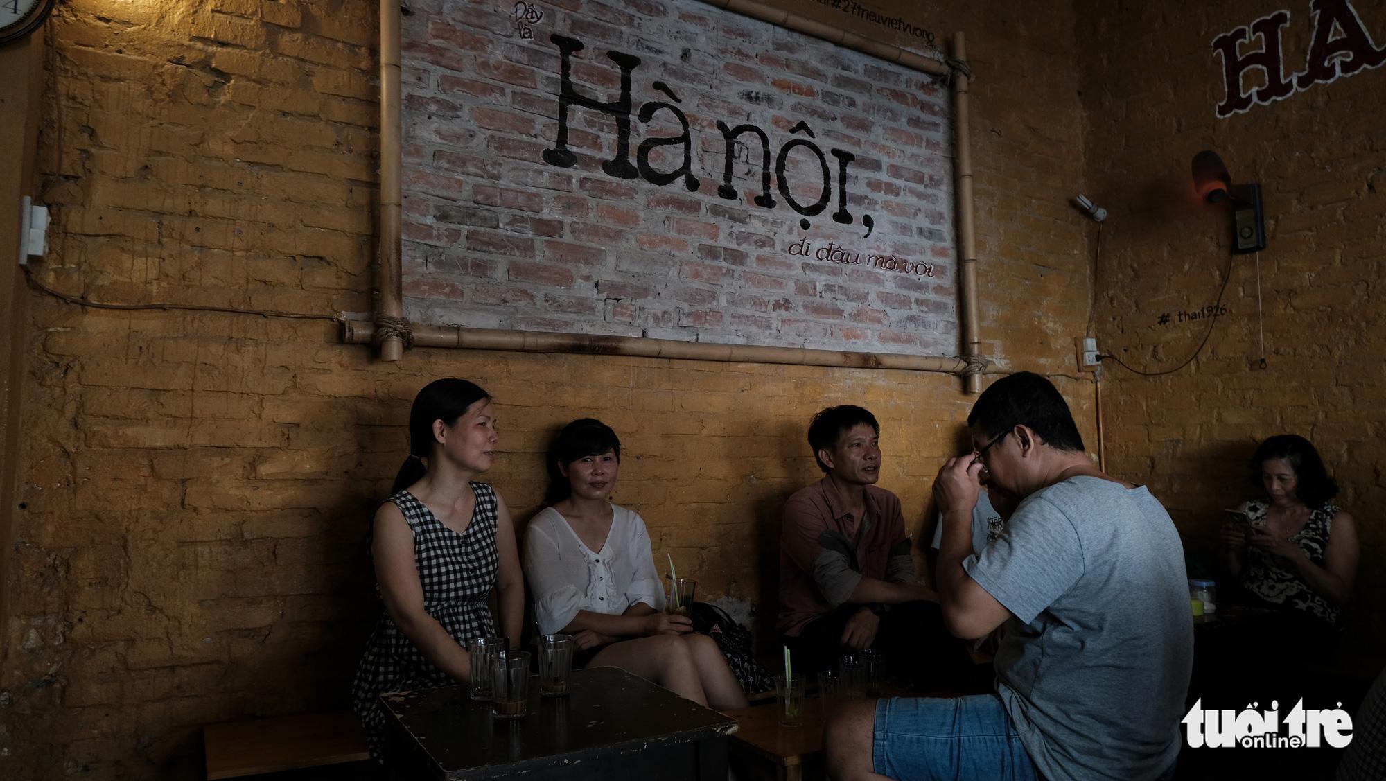 Customers enjoy coffee and chitchat at Thai Café on Trieu Viet Vuong Street in Hai Ba Trung District, Hanoi. Photo: Ha Thanh / Tuoi Tre