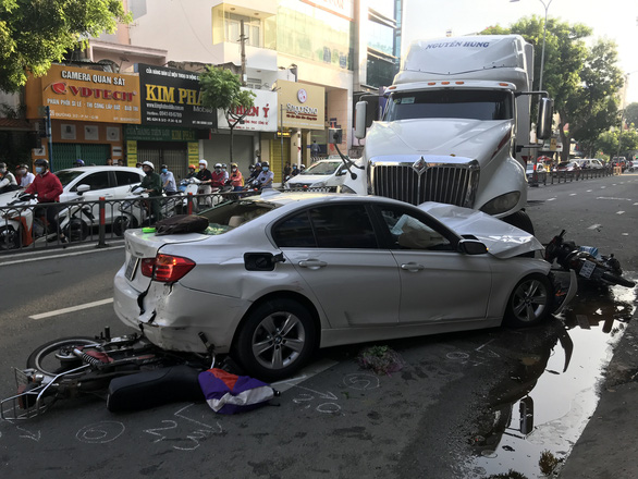 Three injured as tractor-trailer slams into car, motorbikes in Ho Chi Minh City
