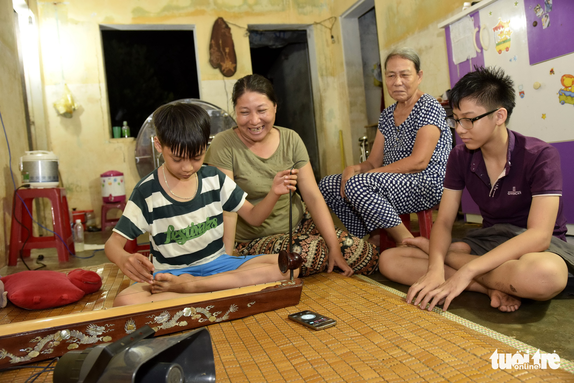 In Vietnam, elderly woman, daughter peddle to support grandson's pursuit of traditional music