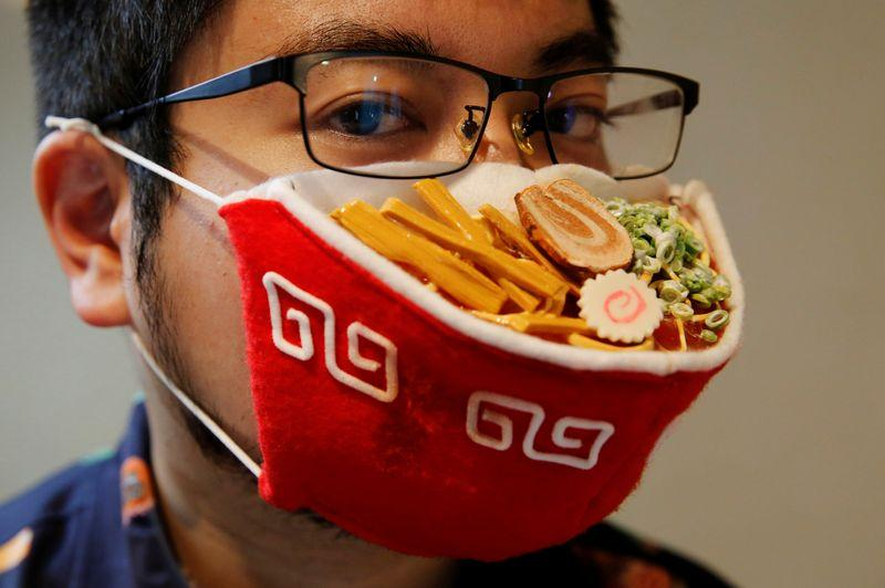 Japanese designer Takahiro Shibata's wears a protective mask that looks like a steaming bowl of ramen noodle soup while posing for a photo at his house, following the coronavirus disease (COVID-19) outbreak in Yokohama, Japan September 23, 2020. Photo: Reuters
