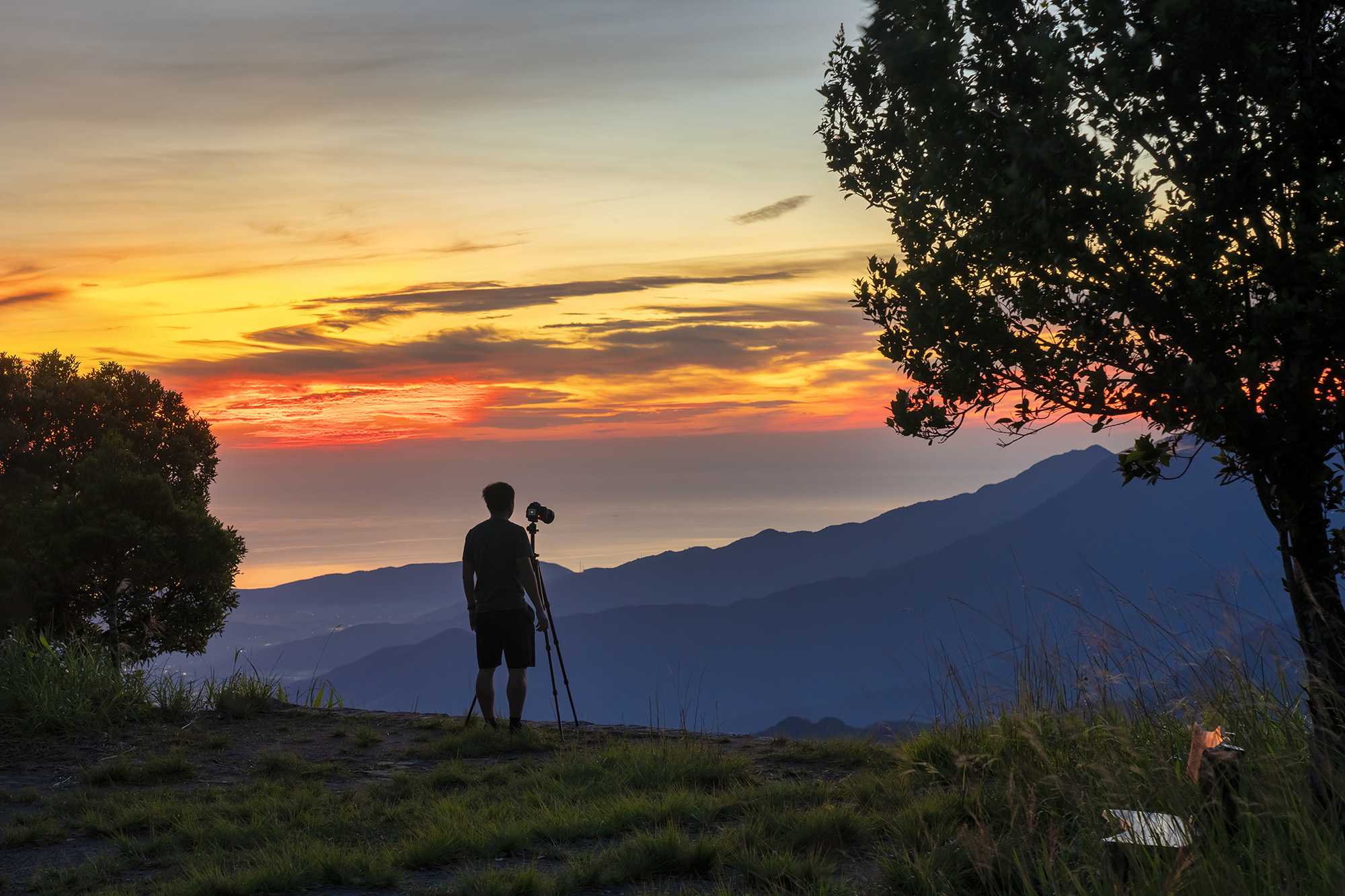 A tourist sets up a tripod to take pictures of the breathtaking scenery in Bach Ma National Park in Thua Thien-Hue Province, Vietnam. Photo: Tran Luu Anh Tuan / Tuoi Tre