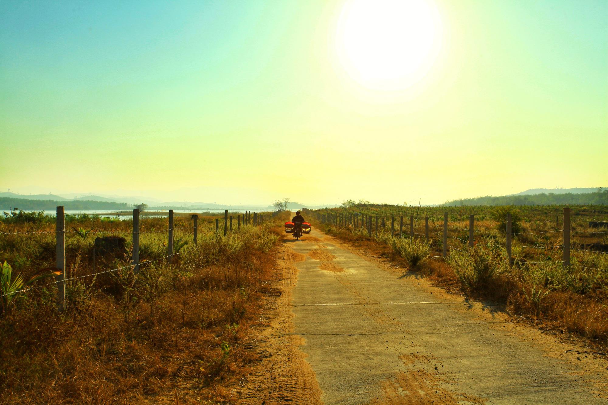 A motorist drives towards sunset near Se San Lake in Kon Tum Province, Vietnam. Photo: Chieu Ly / Tuoi Tre