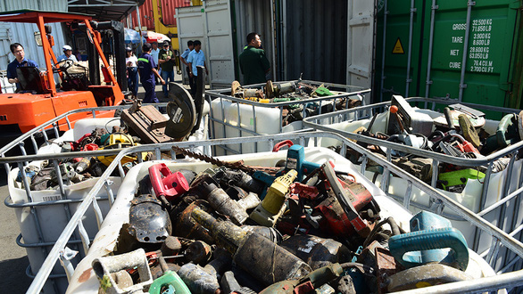 Authorities examine containers of unqualified scrap at a port in Ho Chi Minh City. Photo: Quang Dinh / Tuoi Tre
