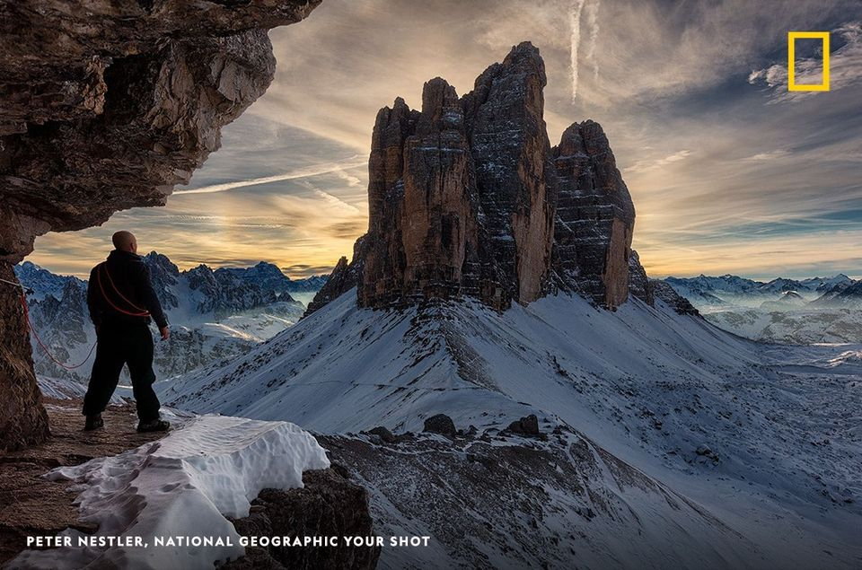 Your Shot photographer Peter Nestler's photo capturing him admiring Tre Cime di Lavaredo in the Italian Alps.