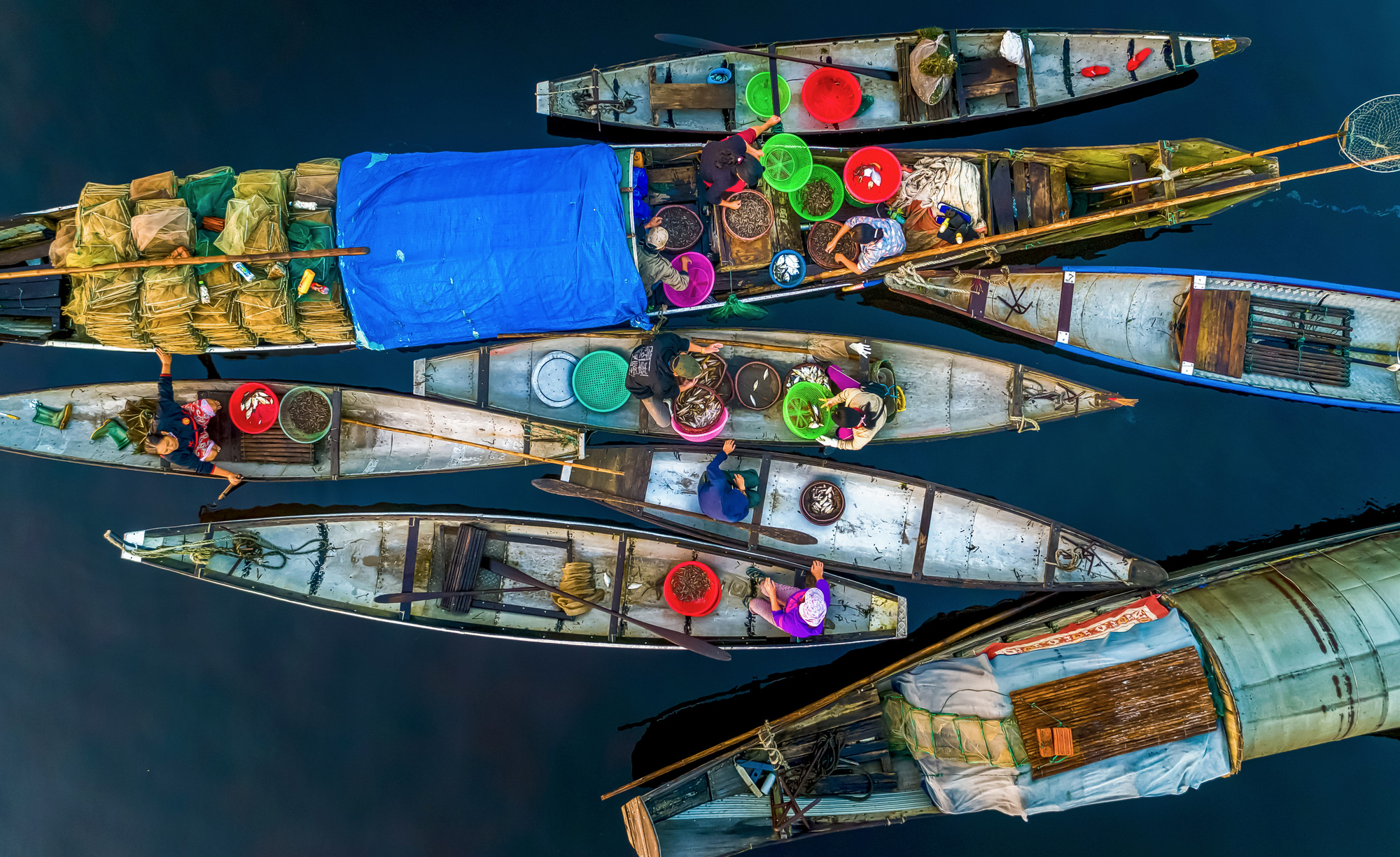 A floating market on the Tam Giang Lagoon in Thua Thien-Hue Province, Vietnam. Photo: Kelvin Long / Tuoi Tre