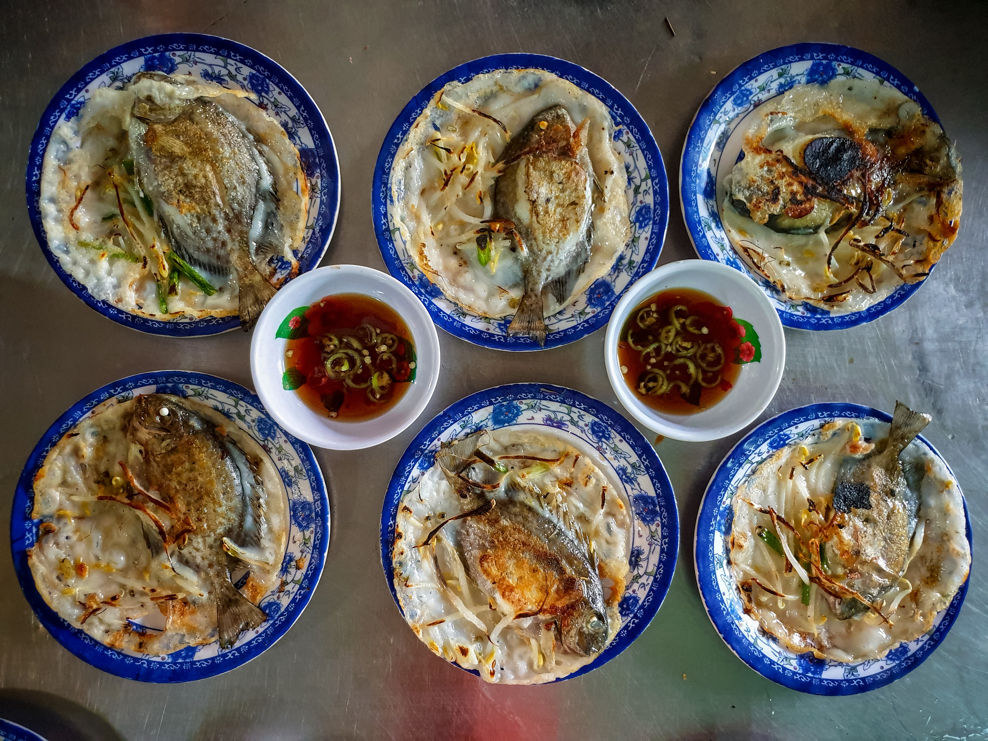 Servings of 'banh xeo' (Vietnamese pancake) served with ray-finned fish, a specialty of Hue, is a must for food lovers visiting the Tam Giang – Cau Hai Lagoon in Thua Thien-Hue Province, Vietnam. Photo: Kelvin Long / Tuoi Tre