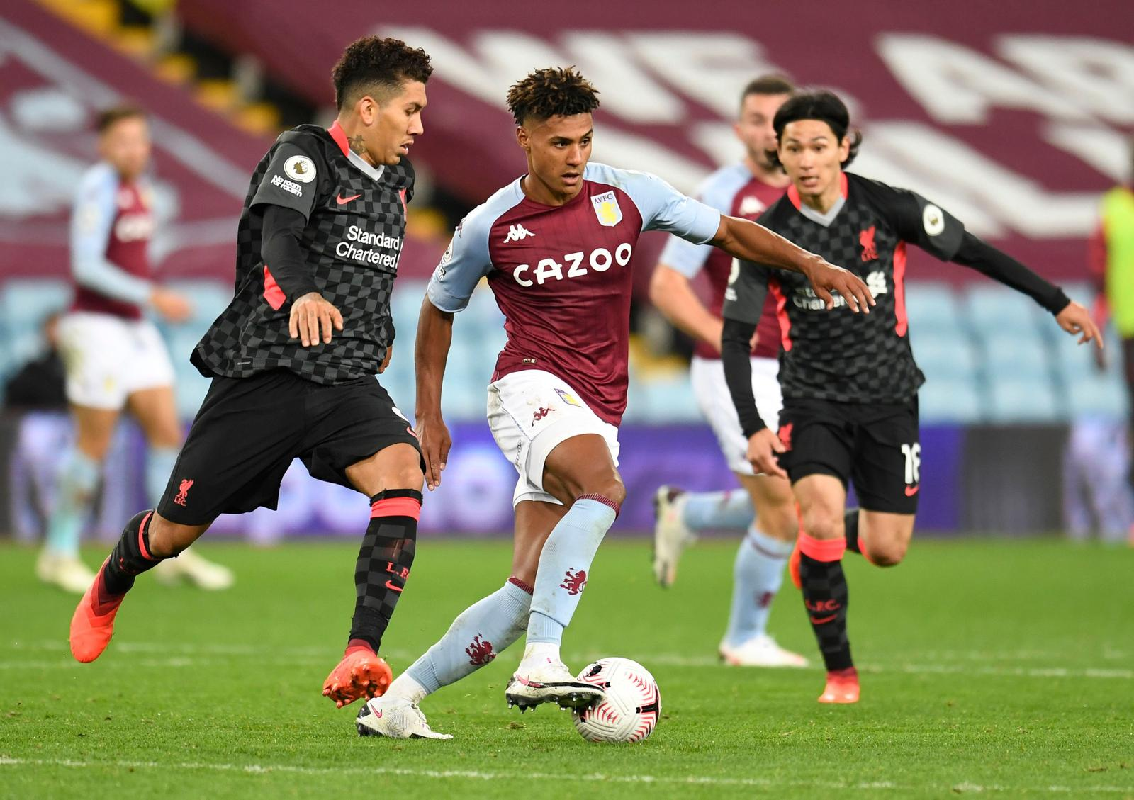 Aston Villa's Ollie Watkins in action with Liverpool's Roberto Firmino and Takumi Minamino -  Premier League - Aston Villa v Liverpool - Villa Park, Birmingham, Britain - October 4, 2020. Photo: Reuters