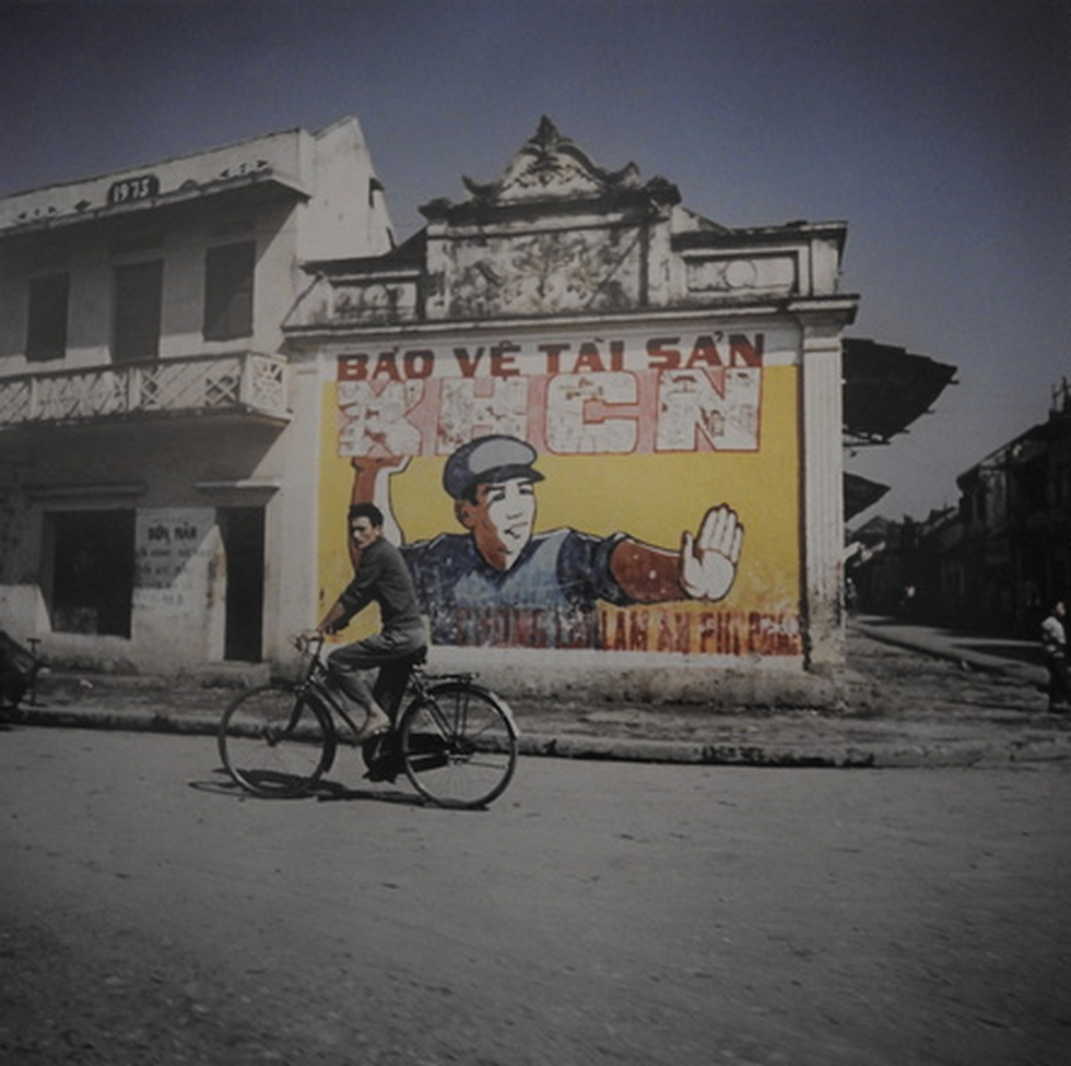 A man cycles past a propaganda wall painting in Hanoi in this photo taken by German photographer Thomas Billhardt during the 1967-75 period.