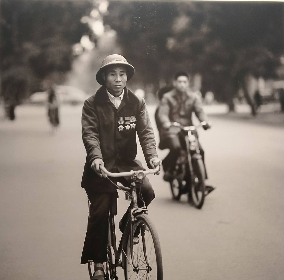 A man cycles on a street in Hanoi in this photo taken by German photographer Thomas Billhardt during the 1970s.