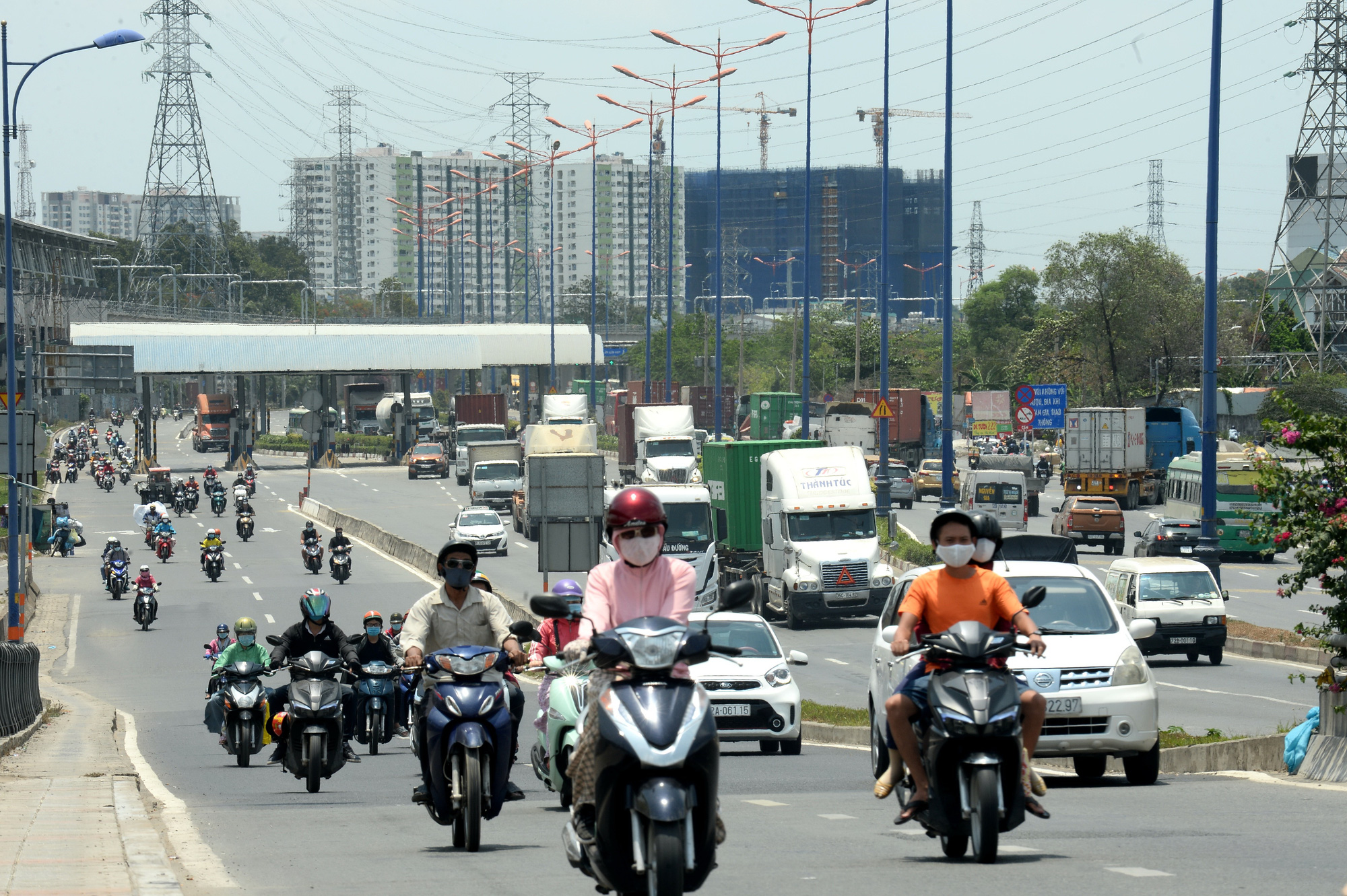 People travel on a street located in the future new city. Photo: Tu Trung / Tuoi Tre
