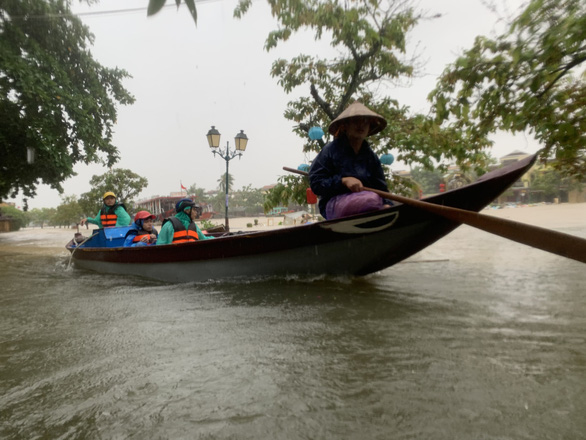 Residents of Hoi An City commute on a boat in this photo taken in Hoi An City on Sunday. Photo: B.D. / Tuoi Tre