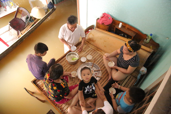 Living on the brink: Families in central Vietnam grapple to survive in flooded houses