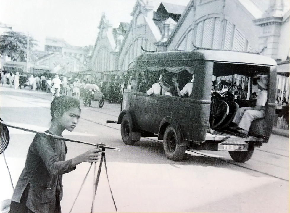 A peddler is seen in front of Hanoi's iconic Dong Xuan Market in 1951 in one of the photos.