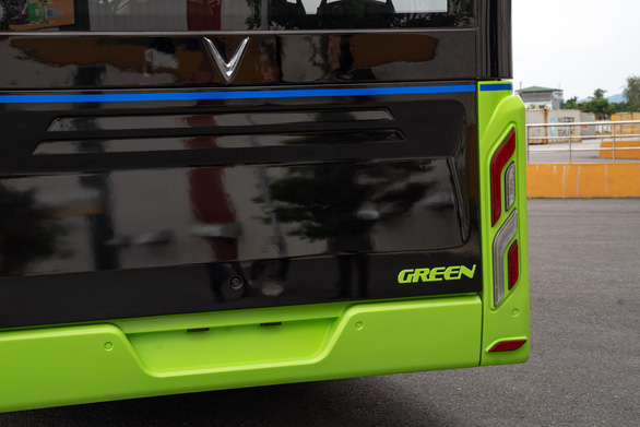 "The rear of a Vinfast's electric bus with ""green"" printed on the outside. Photo: B.C. / Tuoi Tre"