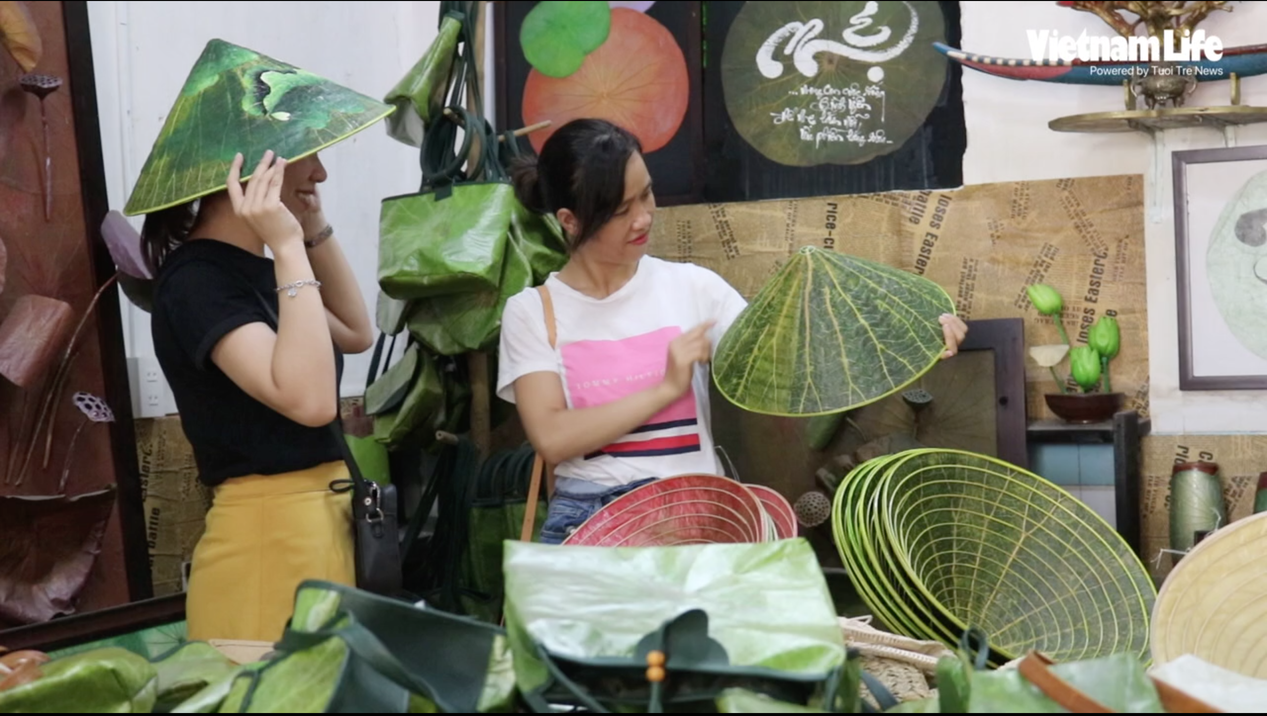 Vietnamese student makes conical hats from lotus leaves