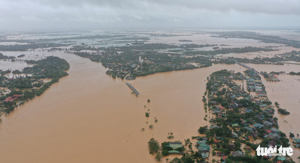 This aerial photo shows a vast flooded region in central Vietnam. Photo: Truong Trung / Tuoi Tre
