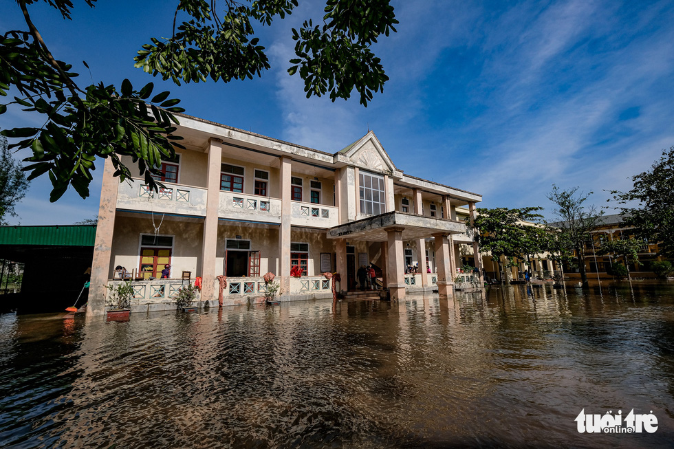 The Cam Quang Elementary School in Ha Tinh Province is seen knee-deep in water in this photo taken on Thursday. Photo: Nam Tran / Tuoi Tre