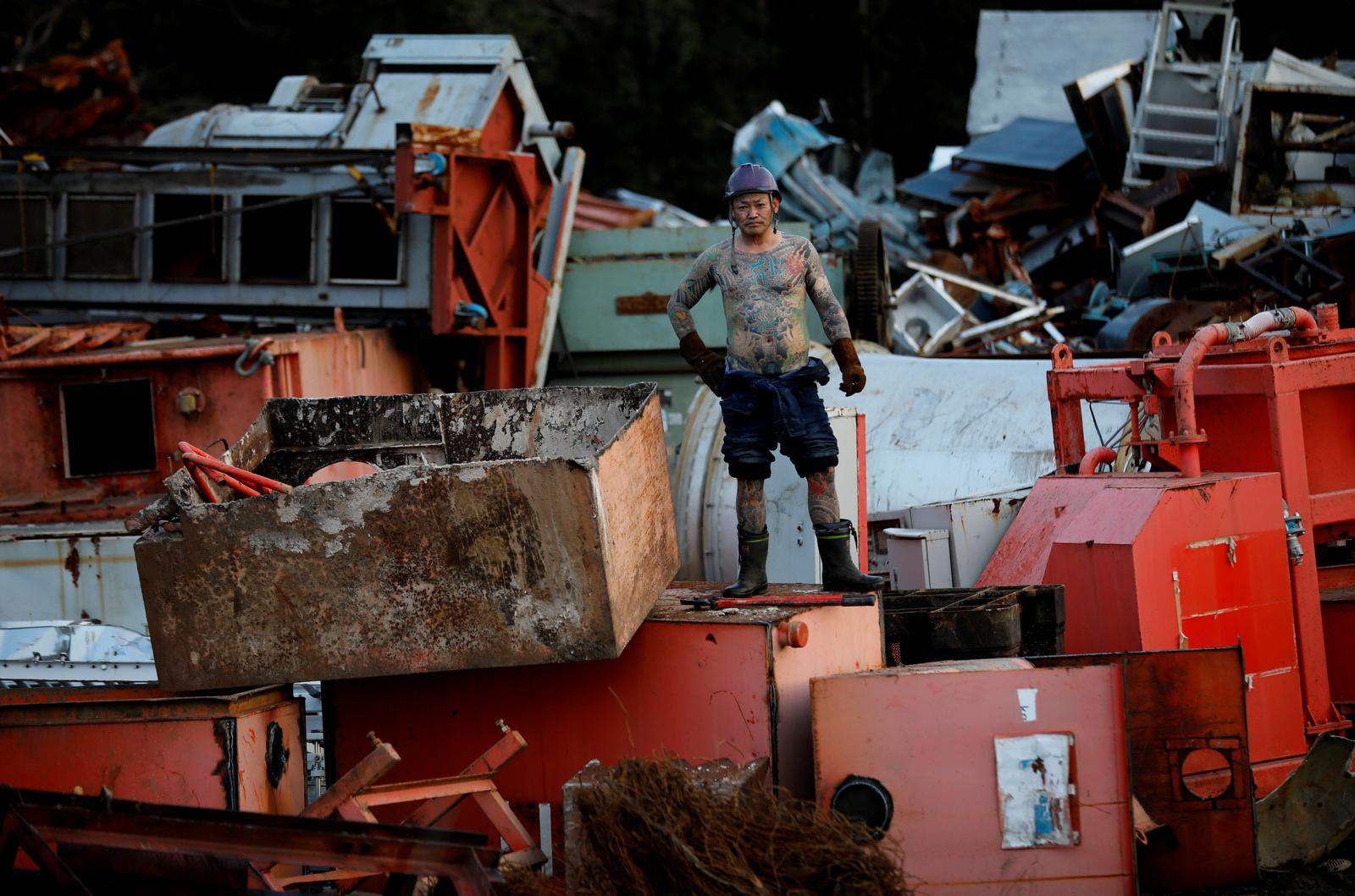 Scrap yard worker Hiroyuki Nemoto, 48, poses at the scrap yard where he works in Hitachinaka, Ibaraki Prefecture, Japan, January 10, 2020. Photo: Reuters
