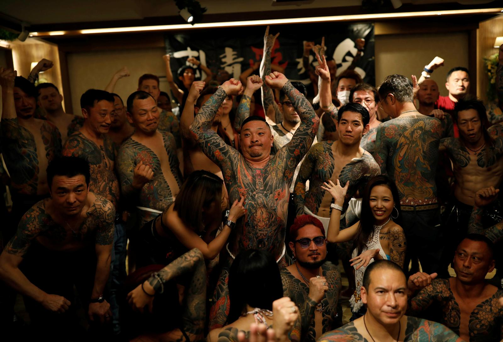 People with tattoos gather together for group photos at the annual gathering of the Irezumi Aikokai (Tattoo Lovers Association) in Tokyo, Japan, February 16, 2020. Photo: Reuters