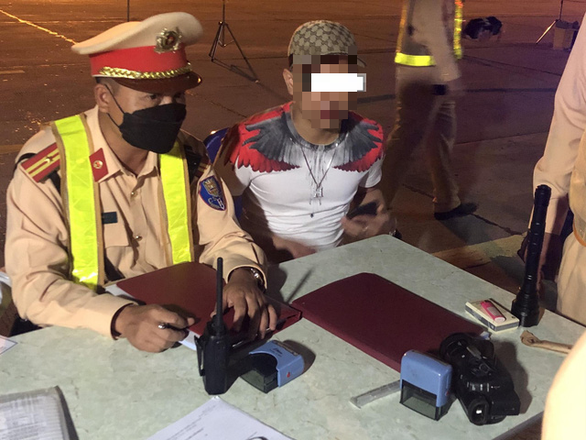 Traffic police examine a driver - who later tested positive for illegal drugs – in this photo supplied by the Department of Traffic Police.