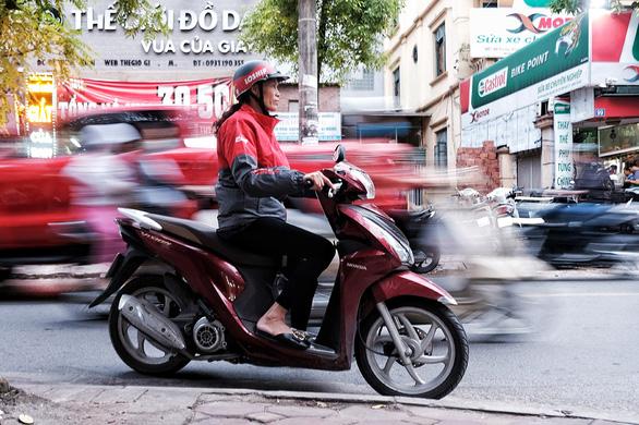 In Vietnam, women find arduous tech-based delivery job rewarding