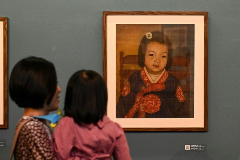 Bich specialises in silk paintings of daily life and ordinary people. Photo: AFP
