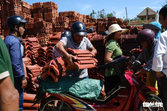 Central Vietnamese province's people flock to buy new tiles to fix houses after storm