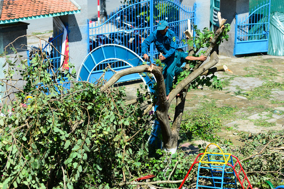 Military personnel help Binh Chau Secondary School of Quang Ngai Province cleans up after typhoon Molave.