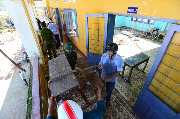 Teachers at Binh Chau Secondary School of Quang Ngai Province clean up the school's facilities