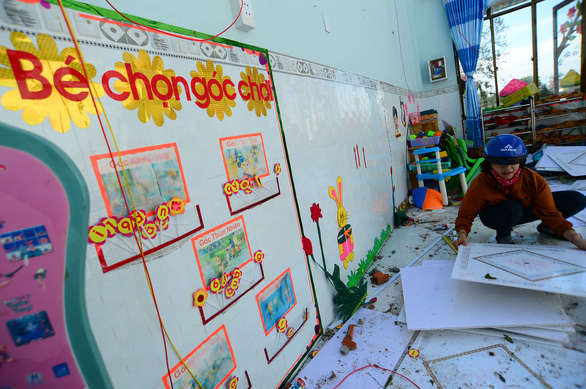 A teacher in Tinh Khe Kindergarten of Quang Ngai City cleans up the debris in a classroom after Typhoon Molave