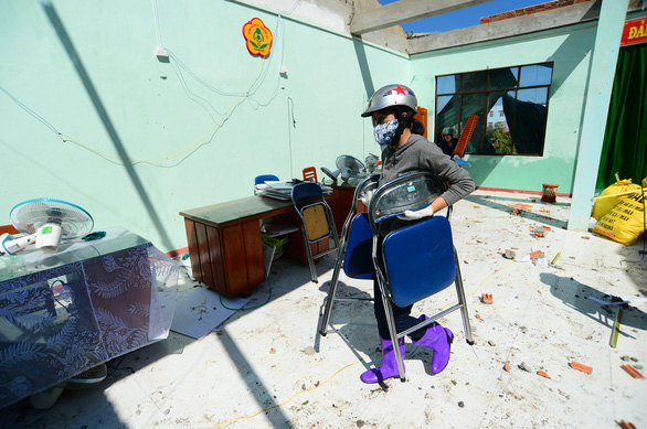 A person cleans up facilities of Tinh Khe Kindergarten of Quang Ngai City after Typhoon Molave