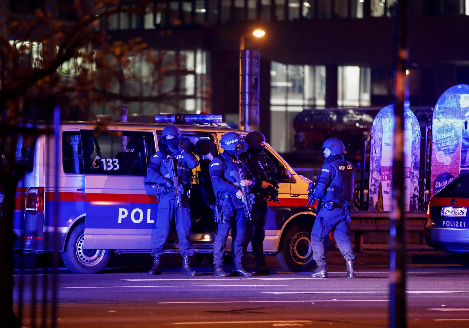 Police officers stand guard on a street after exchanges of gunfire in Vienna, Austria November 3, 2020. Photo: Reuters