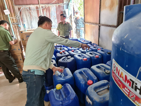 Boxes of chemicals with unclear origins discovered in a police raid in Binh Duong Province. Photo: Ba Son / Tuoi Tre