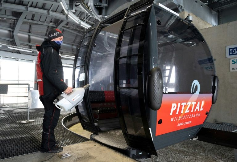 A worker disinfects a cable car cabin at Pitztal glacier, Austria on October 29, 2020. Photo: AFP